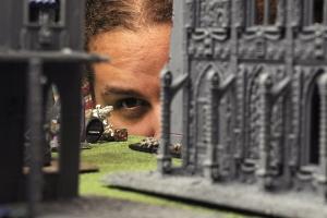 A Gigabite's regular eyeballs a shot during a game at the popular wargaming café.