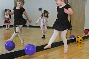Elizabeth Cates, 4, kicks a ball along the side of a mirror during Burnt Hickory's Dancing Fantasy Class in Dallas. lefin Date Published 4-5-12