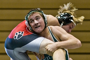 Westminster's Davis Houk takes down Jackson County High School's Zachary Evans during a match.  lefin Date Published: 01/24/12