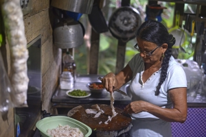 Grace Jimenéz pulls apart lionfish filets to make ceviche. Jimenéz developed the now popular ceviche recipe that is mimicked by restaurants throughout the Southern Caribbean.